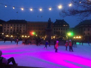 Children skating in the town centre during early evening hours.