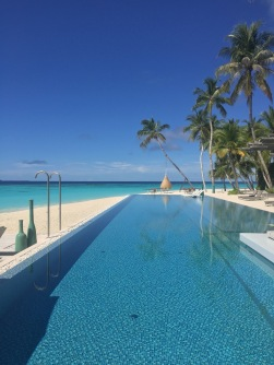 Pool and beach by day.